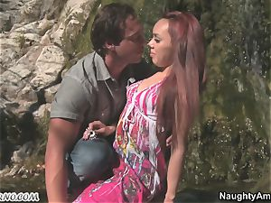Exotic porn with a red-haired tanned latina near a waterfall