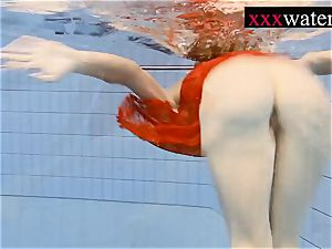 cool super-steamy dame swimming in the pool